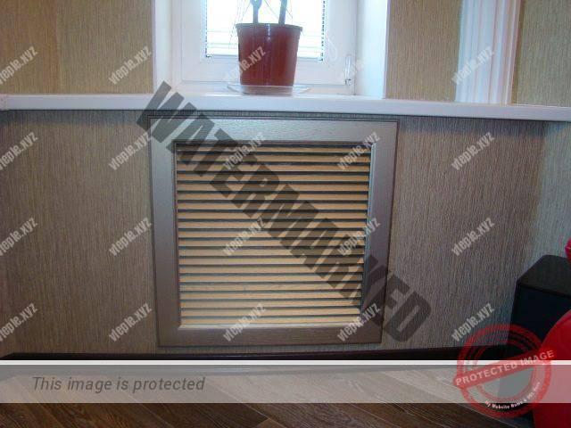 Декоративная решетка на радиаторе в нише под окном